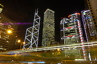 Central business district at night in Hong Kong. From left to right, the Bank of China building, the Cheung Kong Centre, the Hongkong & Shanghai Bank building..