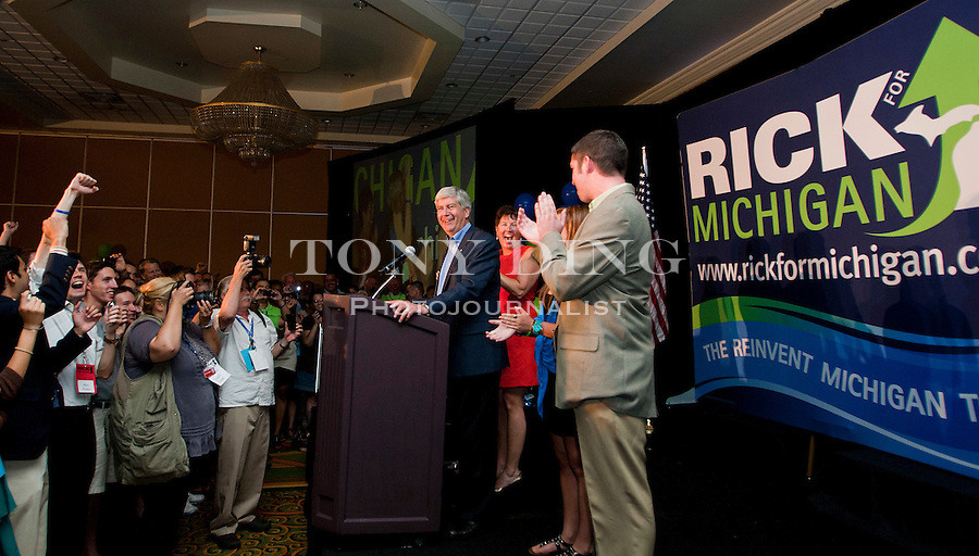 Michigan Republican gubernatorial candidate Rick Snyder, center, stands before his supporters at a victory party after the day's primary election, Tuesday, Aug. 3, 2010, in Ypsilanti, Mich. Snyder edged out Michigan Attorney General Mike Cox and U.S. Congressman Pete Hoekstra to face Democratic nominee, and Lansing, Mich. Mayor Virg Bernero, in the November general election. (AP Photo/Tony Ding)