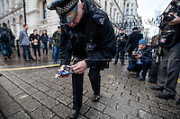 A Downing Street Police Officer (Diplomatic Protection Group - DPG) collects the medals.  <br />