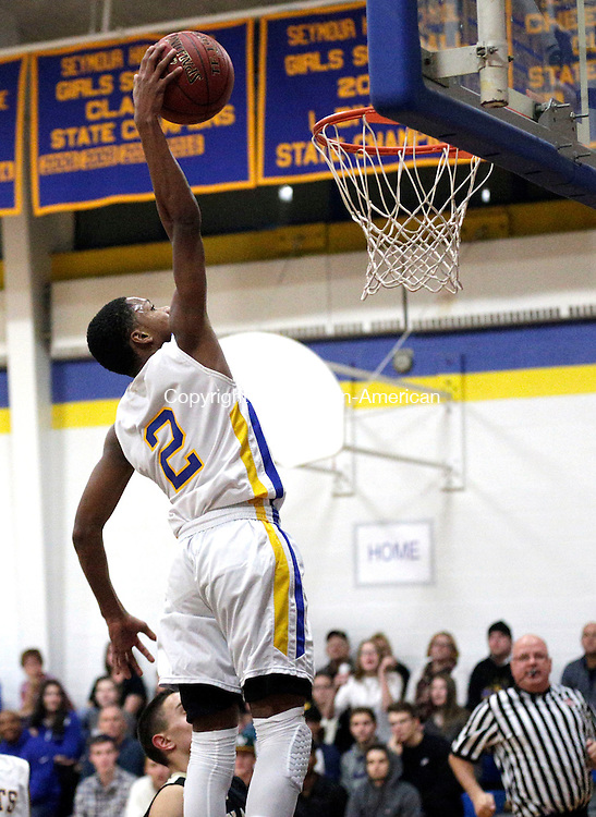 Seymour, CT- 22 December 2016-122216CM14-  Seymour's Kevin Crawford takes the ball in for a dunk during their NVL matchup against Woodland on Thursday.   Christopher Massa Republican-American