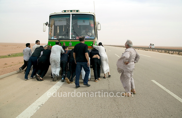 Shia Muslims in the UK / Eduardo Martino.On the way out from Iraq, the group of pilgrims from the UK get stuck in the desert as the bus breaks down near the Sunni Triangle, a place packed with guerrilla fighters against the foreign presence, West Iraq, February 2004.