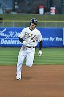 John Hester (22) of the Salt Lake Bees hustles towards third base against the Sacramento River Cats at Smith's Ballpark on April 3, 2014 in Salt Lake City, Utah.  (Stephen Smith/Four Seam Images)