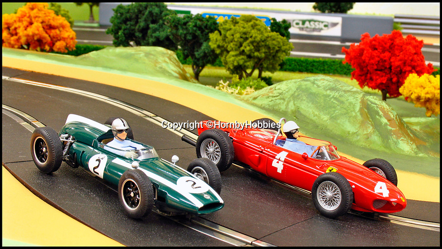 BNPS.co.uk (01202 558833)Pic: HornbyHobbies/BNPS<br /> <br /> 2005 C2639A Cooper Climax and C2640A Ferrari 156.<br /> <br /> These fascinating photos tell the story of 60 years of Scalextric which grew from humble beginnings into a British institution. <br /> <br /> When enterprising Freddie Francis launched the car racing toy in 1957 at his factory in Havant, Hants, he could never have known they would still be a household name 60 years later.<br /> <br /> Today, Scalextric are produced by English toy maker Hornby Hobbies and demand for the much-loved slot cars is still as strong as ever.