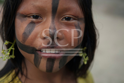 Aldeia Baú, Para State, Brazil. Kayapo girl with face paint which she has applied herself while learning.