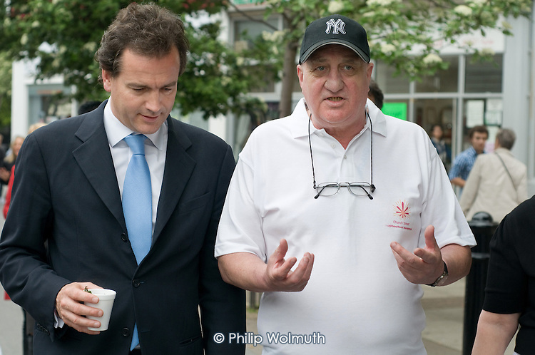 Conservative MP Nick Hurd, newly appointed Minister for Civil Society, talks with Community Engagement Officer John MacDonald during a visit to projects in Church Street, London,  supported by the Paddington Development Trust.