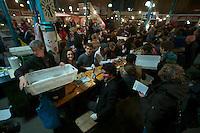"""Bis zu 600 Menschen versammelten sich am Freitag den 18. Januar 2013 in Berlin-Kreuzber zu einer sog. """"Schnippel-Disco"""". <br />750 kg knubbeliges, unschoenes und<br />ungewolltes Gemuese welches fuer den """"normalen Handel"""" zu klein, zu groß oder zu dick ist wurde fuer eine Protestsuppe geschnippelt. Die Suppe soll auf der """"WIR HABEN ES<br />SATT""""-Demo am Samstag den 19. Januar fuer mehere tausend Menschen gekocht werden.<br />Veranstaltet wurde die Aktion u.a. von den Organisatoren der Demonstartion sowie vom Slow Food Deutschland e.V. um ein Zeichen gegen die unsinnige Verschwendung von Lebensmittel zu setzen.<br />18.1.2013, Berlin<br />Copyright: Christian-Ditsch.de<br />[Inhaltsveraendernde Manipulation des Fotos nur nach ausdruecklicher Genehmigung des Fotografen. Vereinbarungen ueber Abtretung von Persoenlichkeitsrechten/Model Release der abgebildeten Person/Personen liegen nicht vor. NO MODEL RELEASE! Don't publish without copyright Christian-Ditsch.de, Veroeffentlichung nur mit Fotografennennung, sowie gegen Honorar, MwSt. und Beleg. Konto:, I N G - D i B a, IBAN DE58500105175400192269, BIC INGDDEFFXXX, Kontakt: post@christian-ditsch.de<br />Urhebervermerk wird gemaess Paragraph 13 UHG verlangt.]"""