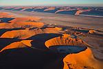 Namibia;  Namib Desert, Namib-Naukluft National Park, Tsauchab River valley between red sand dunes near Sossusvlei, aerial view