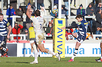 21.02.2015.  Sale, England.  Aviva Premiership Rugby. Sale Sharks versus Saracens. Sale Sharks fly-half Danny Cipriani kicks the ball over Saracens flanker Jacques Burger.