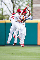 Mike O'Neill #7, Chris Swauger #28, and Thomas Pham #27 of the Springfield Cardinals celebrate after defeating the Tulsa Drillers at Hammons Field on May 7, 2013 in Springfield, Missouri. (David Welker/Four Seam Images)