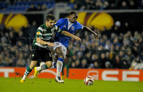 2010 Everton v Sporting Feb 16, Goodison Park Louis Saha battles with Sporting Lisbon defender in close duel for ball. Photo: Alan Edwards/Actionplus. - Editorial Use
