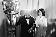 Hollywood, Los Angeles, California, USA. April 15th, 1972 . The English actor Charlie Chaplin, with his wife Oona, after having received a Honorary Academy Award for his career.