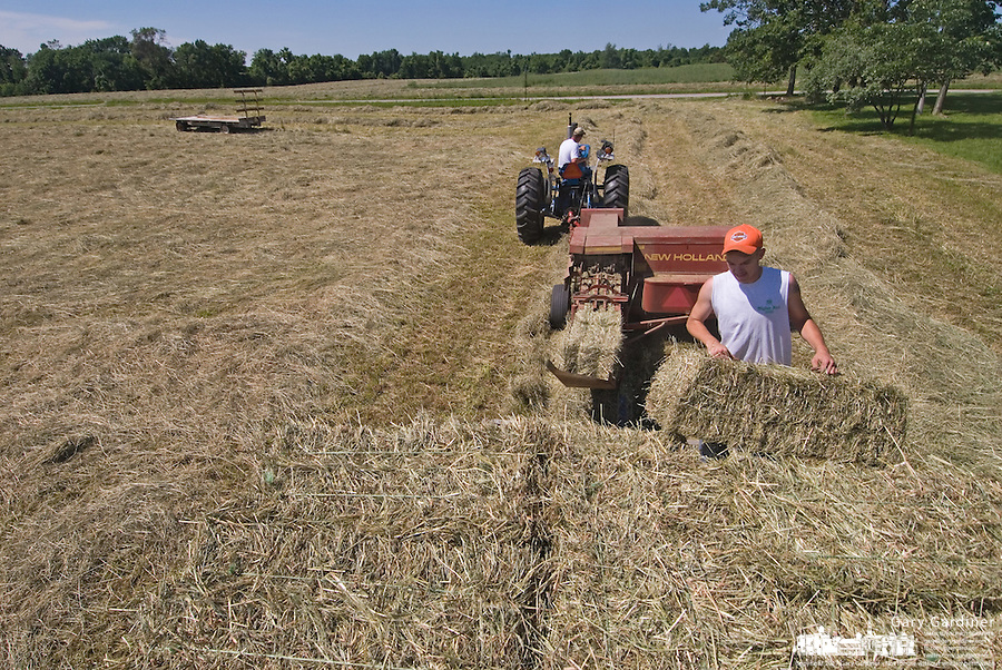 Hay is loaded onto a trailer after harvest near Jersey, Ohio.