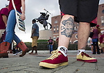 Florida State fan John Crump, from Keystone Heights, FL., shows off his signed Bobby Bowden tattoo outside Doak Campbell stadium prior to FSU's NCAA college football game against Clemson in Tallahassee, Fla., Saturday, Sept. 20, 2014.  (AP Photo/Mark Wallheiser)