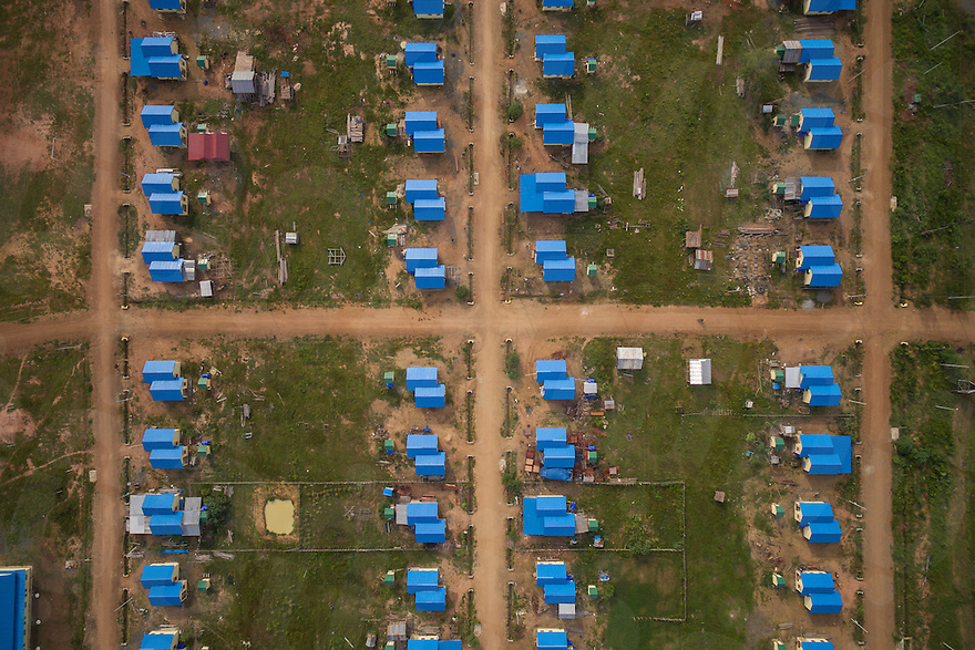 August 19, 2016 - Stung Treng (Cambodia). Aerial view of the relocation village built by authorities for people that were living in the Lower Sesan 2 Dam reservoir area. The 400-MW dam—a joint venture between Cambodian businessman Kith Meng and China's Hydrolancang International Energy Co. Ltd.—is set to displace more than 5,000 villagers in Sesan district. Studies claim that the dam could seriously affect fisheries, and in turn the livelihoods of more than 100,000 residents living upstream and downstream of the dam. © Thomas Cristofoletti / Ruom