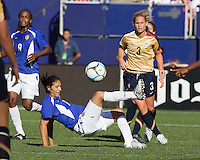 Cristiane kicks the ball away from a closing Christie Rampone. USA defeated Brazil 2-0 at Giants Stadium on Sunday, June 23, 2007.