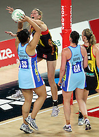 28.06.2010 Magic's Casey Williams and Steels Julianna Naoupu in action during the ANZ Champs Semi Final netball match between the Magic and Steel played at Vector Arena in Auckland. ©MBPHOTO/Michael Bradley