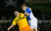 Tom Lockyer of Bristol Rovers beats Garry Thompson of Wycombe Wanderers in the air during the Sky Bet League 2 rearranged match between Bristol Rovers and Wycombe Wanderers at the Memorial Stadium, Bristol, England on 1 December 2015. Photo by Andy Rowland.