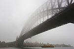 Sydney Harbour and surrounding buildings in early morning fog. Sydney, Australia. Tuesday May 28th 2013. Photo:( Steve Christo).