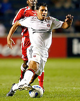 DC United midfielder Christian Gomez (10) dribbles toward the Chicago Fire goal.  The Chicago Fire defeated the DC United 3-0 in the semifinals of the U.S. Open Cup at Toyota Park in Bridgeview, IL on September 6, 2006...