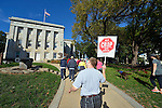 Participants walk past government buildings during the CROP Hunger Walk, held October 27, 2013, in Raleigh, North Carolina.