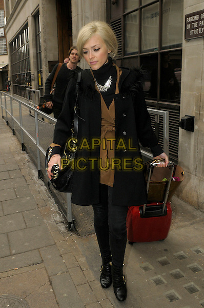 Fearne Cotton and Jesse Wood leaving BBC Radio 1, London, England..17th February 2012.full length black jeans denim boots coat jacket suitcase luggage bag purse brown dress couple .CAP/IA.©Ian Allis/Capital Pictures.