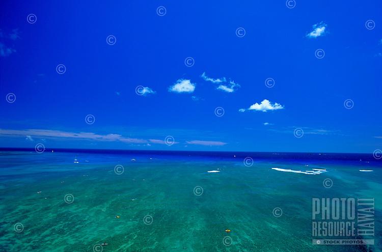 Expansive brilliant blue ocean meets the beautiful blue sky off Waikiki.