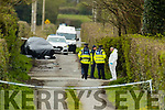 Gardai at the scene of A murder investigation at Ratoo, Ballyduff on Tuesday. The deceased has been named locally as Anthony O'Mahony (74), a life-long farmer who was very well known in the community.