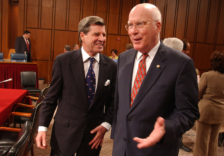 Ambasssdor to Iraq Paul Bremer, left, chats with Sen. Pat Leahy, D-Vt., before a Senate Appropriations Hearing on the budget for the war in Iraq.