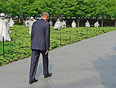 United States President Barack Obama departs after laying a wreath prior to delivering remarks marking the 60th Anniversary of the Korean War Armistice at the Korean War Veterans Memorial in Washington, D.C. on Saturday, July 27, 2013.<br /> Credit: Ron Sachs / Pool via CNP