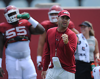 NWA Democrat-Gazette/ANDY SHUPE<br /> Arkansas tight ends coach Barry Lunney Jr. instructs players Thursday, Aug. 13, 2015, during practice at the university practice field in Fayetteville.