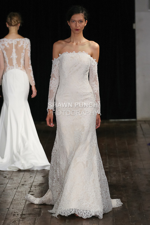 "Model walks runway in a ""Romance"" bridal gown from the Alyne by Rita Vinieris Fall 2017 collection on October 7th, 2016 during New York Bridal Fashion Week."
