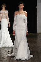 """Model walks runway in a """"Romance"""" bridal gown from the Alyne by Rita Vinieris Fall 2017 collection on October 7th, 2016 during New York Bridal Fashion Week."""