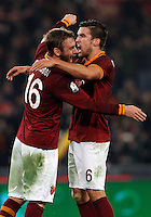 Calcio, quarti di finale di Coppa Italia: Roma vs Juventus. Roma, stadio Olimpico, 21 gennaio 2014.<br /> AS Roma midfielders Daniele De Rossi and Kevin Strootman, of the Netherlands, right, celebrate at the end of the Italian Cup round of eight final football match between AS Roma and Juventus, at Rome's Olympic stadium, 21 January 2014. AS Roma won 1-0.<br /> UPDATE IMAGES PRESS/Riccardo De Luca