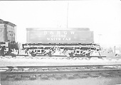 Side view of standard gauge water car #010889.<br /> D&amp;RGW