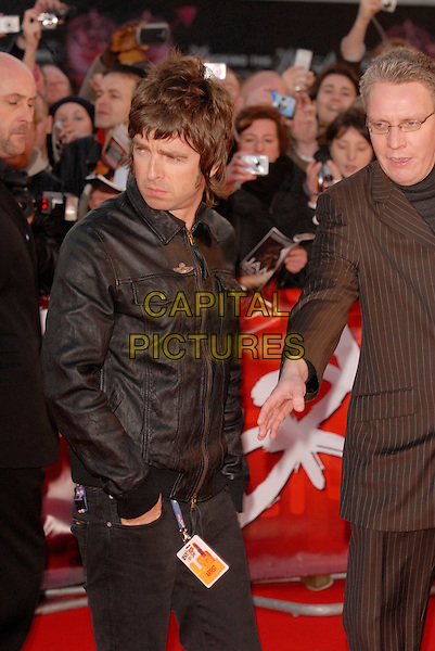 """NOEL GALLAGHER.Arriving at the 2007 """"Brit Awards"""" at Earls Court, London, England, 14th February 2007..half length black jacket leather oasis.CAP/FIN.©Steve Finn/Capital Pictures."""