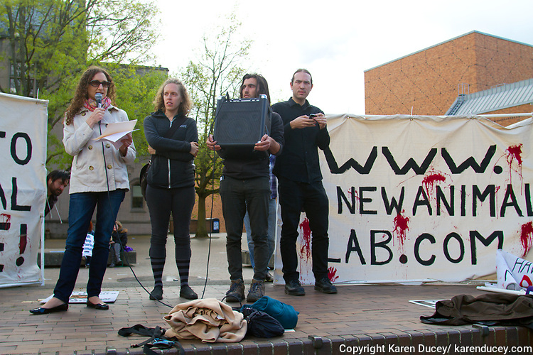 Lauren Gazzola (left) from New York City shares her thoughts on why shutting down animal research facilities matters during a rally protesting the construction of a new $125 million underground animal research lab on campus at the University of Washington in Seattle, Wash. on April 25, 2015. Gazzola was imprisoned in 2006 under the Animal Enterprise Terrorism Act for publishing website aimed at exposing the animal research experimentation at the Huntingdon Life Sciences in New Jersey. (© Karen Ducey Photography)