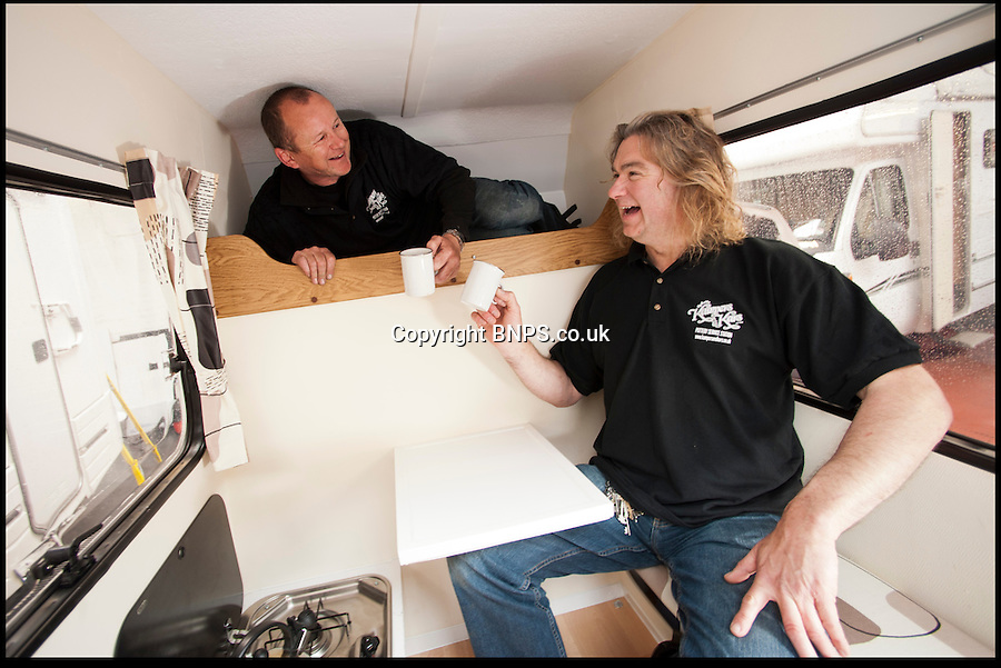 BNPS.co.uk (01202) 558833.Picture: Peter Willows..Andy Saunders and work colleague Martin Ford demonstrate the cramper van...It might only have 4ft of living space but this mini mobile home comes with everything a camper would want including a cooker, a sink, a table and a bed. The 'cramper van' is thought to be the smallest camper van in the world. Creative mechanic Andy Saunders chopped 6ft off the front of a Bedford Bambi campervan and attached it to a Butlins pedal cart before fitting the bespoke interior.