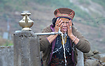 A woman washes her face at a communal water tap in the Tamang village of Goljung, in the Rasuwa District of Nepal near the country's border with Tibet.<br /> <br /> In the aftermath of the April 2015 earthquake that ravaged Nepal, the ACT Alliance helped people in this village with a variety of services, including blankets, shelter and livelihood assistance.