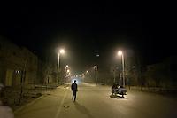 Uighurs walk through the streets of Kashgar, Xinjiang, China, at night.