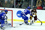 SIOUX FALLS, SD - MARCH 24: Jared Thomas #22 from Minnesota Duluth tries a wrap around shot past Jonathan Kopacka #52 from Air Force during their game at the 2018 West Region Men's NCAA DI Hockey Tournament at the Denny Sanford Premier Center in Sioux Falls, SD. (Photo by Dave Eggen/Inertia)