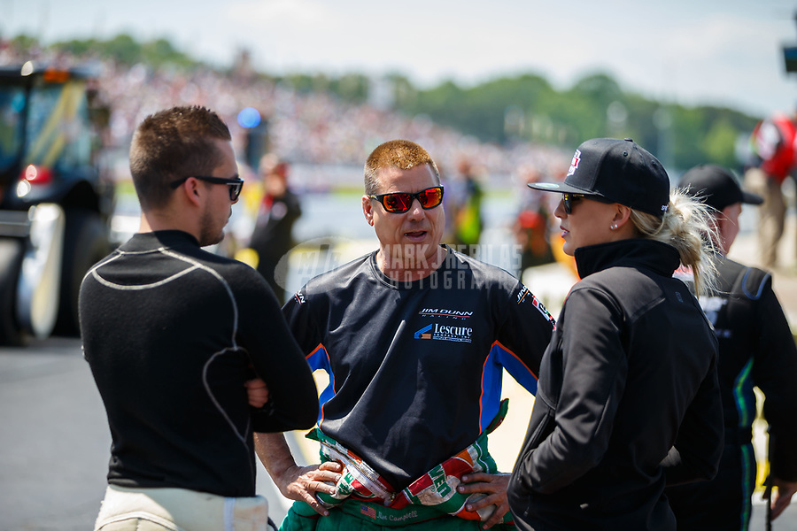 May 6, 2017; Commerce, GA, USA; NHRA funny car driver Jim Campbell (center) talks with Jonnie Lindberg (left) and top fuel driver Leah Pritchett during qualifying for the Southern Nationals at Atlanta Dragway. Mandatory Credit: Mark J. Rebilas-USA TODAY Sports