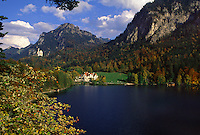 Scenic landscape of the Bavarian Alps and lake with castles in the background. Germany.