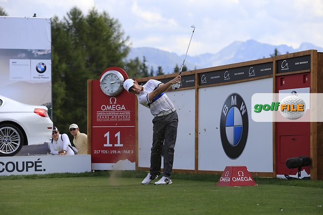 Tommy Fleetwood (ENG) tees off the 11th tee during Saturday's Round 3 of the 2013 Omega European Masters held at Crans Montana Golf Club, Crans-Sur-Sierre Switzerland. 7th September 2013.<br /> Picture: Eoin Clarke www.golffile.ie