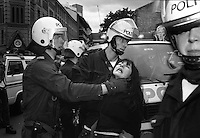 Oslo, Norway 1990: A young girl is being arrested by Norwegian riot police during an illegal demonstraion against Soviet President Gorbatchev in Oslo. Gorbachev held his Nobel peace prize speach at the Oslo City Hall.