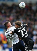 Bolton Wanderers' Gary Madine competing with Leeds United's Kalvin Phillips <br /> <br /> Photographer Andrew Kearns/CameraSport<br /> <br /> The EFL Sky Bet Championship - Bolton Wanderers v Leeds United - Sunday 6th August 2017 - Macron Stadium - Bolton<br /> <br /> World Copyright &copy; 2017 CameraSport. All rights reserved. 43 Linden Ave. Countesthorpe. Leicester. England. LE8 5PG - Tel: +44 (0) 116 277 4147 - admin@camerasport.com - www.camerasport.com