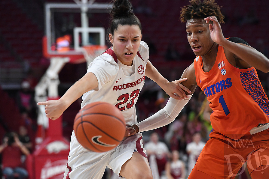 Arkansas' Amber Ramirez and Florida's Kiara Smith vie for a loose ball Sunday Jan. 26, 2020 at Bud Walton Arena. Arkansas won 79-57 and play again on the road Thursday at Alabama. See nwaonline.com/uabball/ for a gallery of images from the game. (NWA Democrat-Gazette/J.T. Wampler)