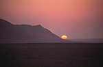 A sunset in the Namib Naukluft desert.  Access is restricted due to Diamond mining activity by DeBeers.