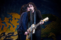 Alison Mosshart and Jack White of The Dead Weather performing in the rain on the Gentilly Stage on Day 7 at the New Orleans Jazz and Heritage Festival at the New Orleans Fair Grounds Race Course in New Orleans, Louisiana, USA, 2 May 2010.