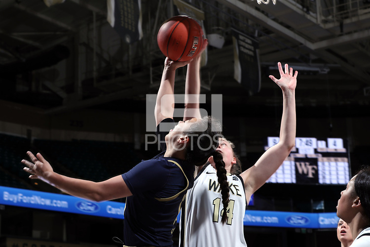 WINSTON-SALEM, NC - FEBRUARY 06: Alex Sharp #14 of Wake Forest University blocks a shot by Marta Sniezek #13 of the University of Notre Dame during a game between Notre Dame and Wake Forest at Lawrence Joel Veterans Memorial Coliseum on February 06, 2020 in Winston-Salem, North Carolina.