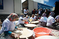 local woman prepare a traditional pancake for the many guests up th emountain<br /> <br /> Tour of Turkey 2014<br /> stage 3